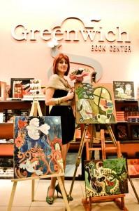"""Дана Кандинска сред картините си, изложени в Книжен център """"Гринуич""""."""